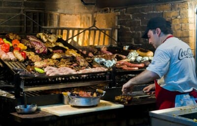 Meat grilling at restaurant in Uruguay. Photo: Kobby Dagan / 123RF Stock Photo