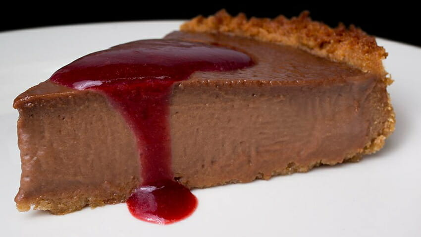"Creamy Vegan Chocolate Mascarpone Cheesecake with a sweet and tart Cherry Coulis drizzle on a homemade graham cracker crust, from <a href=""http://thegentlechef.com/NDECindex.php"" target=""_blank"">The Non-Dairy Evolution Cookbook</a>."
