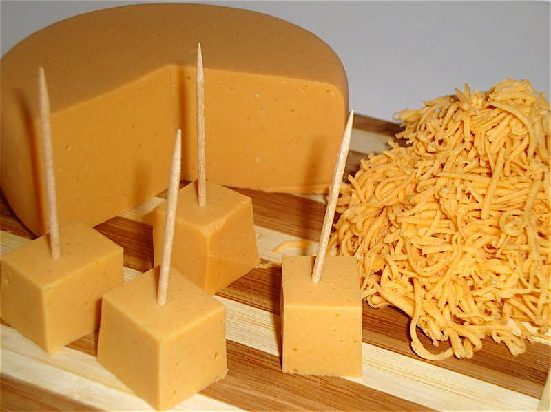 "<a href=""http://thegentlechef.com/NDECindex.php"" target=""_blank"">The Non-Dairy Evolution</a>'s Harvest Smoked Cheddar is a firm cheese with a golden color, mild acidity and rich smoky flavor. Thin slices are ideal for cold sandwiches or for melting on burgers or other grilled sandwiches. This cheese can also be finely shredded and used in your favorite recipes. I have made this one several times and it's remarkably similar to dairy cheddar."