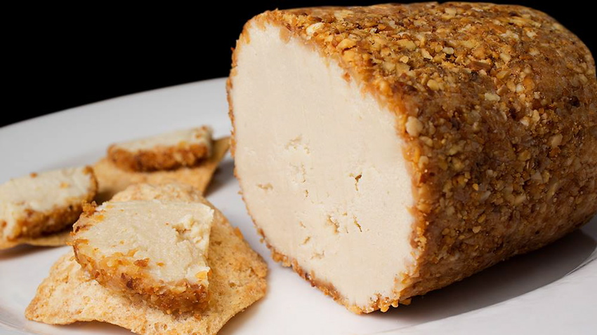 "White Cheddar Amandine from <a href=""http://thegentlechef.com/NDECindex.php"" target=""_blank"">The Non-Dairy Evolution Cookbook</a>. A creamy, cultured sharp vegan cheddar log rolled in toasted almonds. Pair with pita chips or crackers for a truly delectable snack."