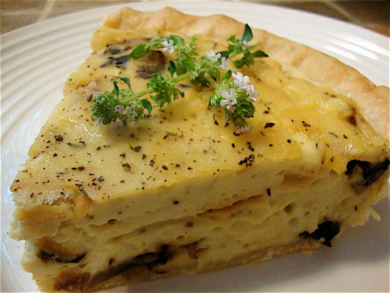 "This savory, fluffy, vegan Mushroom, Onion and Swiss Quiche is filled with a blend of silken tofu custard, shredded Alpine Swiss cheese from <a href=""http://thegentlechef.com/NDECindex.php"" target=""_blank"">The Non-Dairy Evolution Cookbook</a>, and sautéed mushrooms and onions. Perfection."