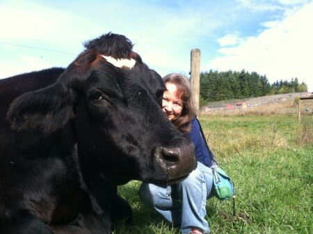Pamela with Martini, a rescued steer, at Precious Life Animal Sanctuary