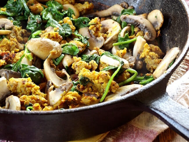Savory chickpea flour scramble with mushrooms and spinach by Connoisseurus Veg.