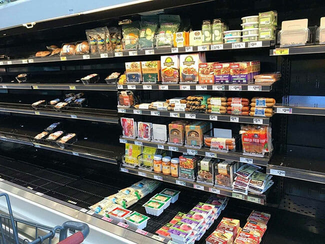Vegan food left on grocery shelves while non-vegan foods are all bought.